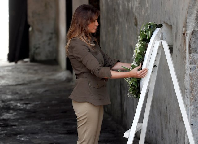U.S. first lady Melania Trump lays a wreath during a visit to Cape Coast castle, Ghana, October 3, 2018. REUTERS/Carlo Allegri