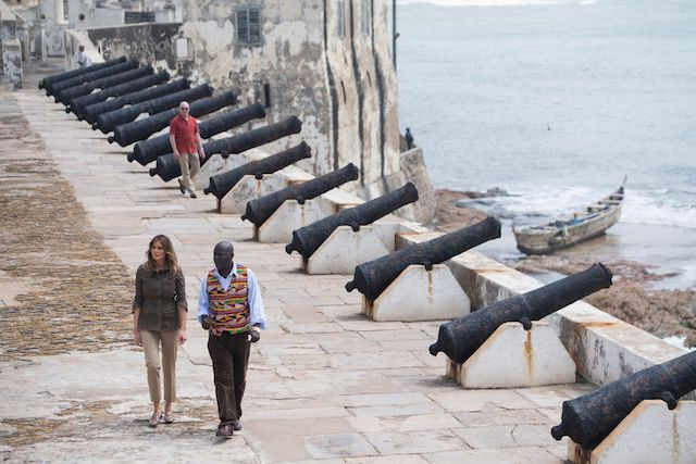 US First Lady Melania Trump with Kwesi Essel-Blankson, Museum Educator, at the Cape Coast Castle, a former slave trading fort, in Cape Coast, on October 3, 2018, during the second day of her week-long trip to Africa to promote her 'Be Best' campaign. (Photo credit should read SAUL LOEB/AFP/Getty Images)