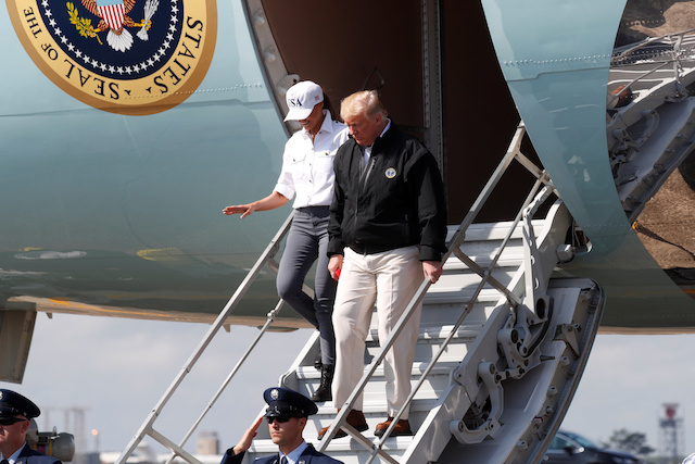 U.S. President Donald Trump steps off Air Force One as the president arrives to tour storm damage from Hurricane Michael at Eglin Air Force Base, Florida, U.S., October 15, 2018. REUTERS/Kevin Lamarque