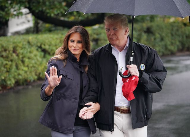 US President Donald Trump and First Lady Melania Trump make their way to board Marine One from the South Lawn of the White House in Washington, DC on October 15, 2018. - Trump is heading to Florida after Hurricane Michael devastated the state. (Photo credit: MANDEL NGAN/AFP/Getty Images)