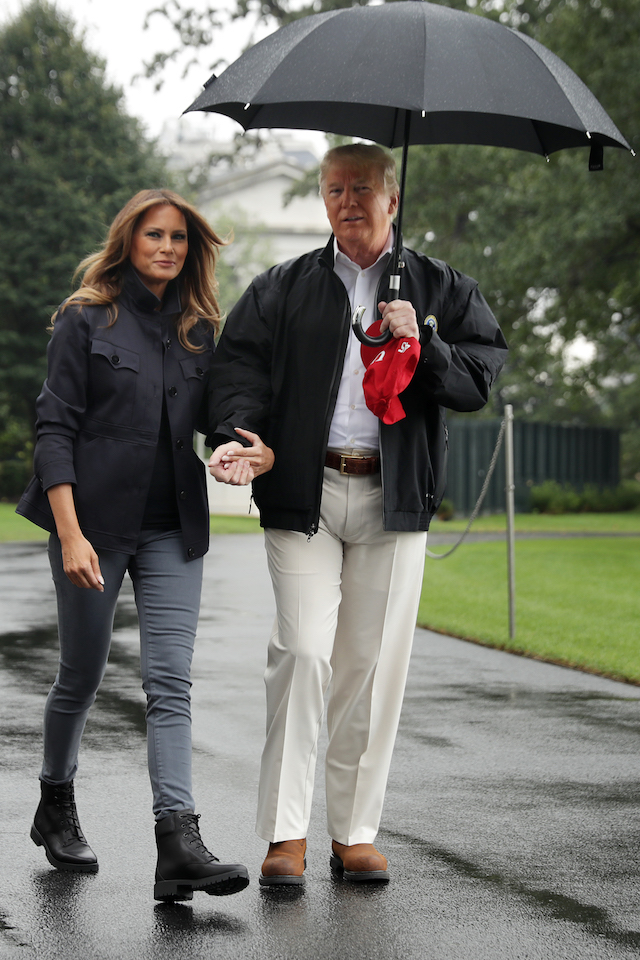 U.S. President Donald Trump and first lady Melania Trump hold hands as they leave the White House October 15, 2018 in Washington, DC. The Trumps are traveling to survey damage from Hurricane Michael, the most powerful storm ever recorded to strike the Florida panhandle. (Photo by Chip Somodevilla/Getty Images)