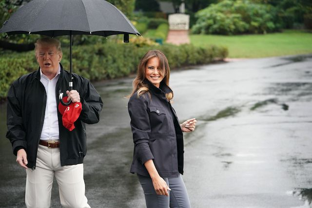 US President Donald Trump and First Lady Melania Trump speak to the press as they make their way to board Marine One from the South Lawn of the White House in Washington, DC on October 15, 2018. - Trump is heading to Florida after Hurricane Michael devastated the state. (Photo credit: MANDEL NGAN/AFP/Getty Images)