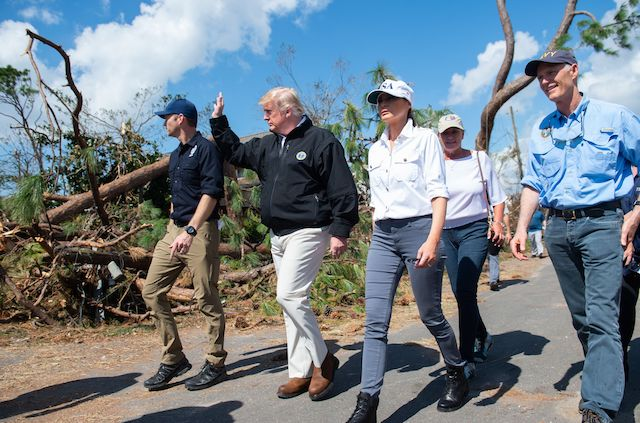 US President Donald Trump, First Lady Melania Trump and Florida Governor Rick Scott(R) tour damage from Hurricane Michael in Lynn Haven, Florida, October 15, 2018. (Photo credit: SAUL LOEB/AFP/Getty Images)