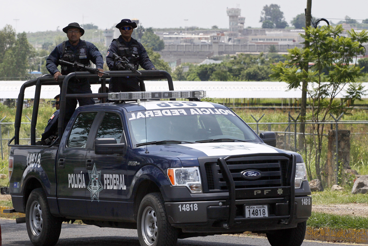 A unit of the Mexican Federal Police patrols the surroundings of the Puente Grande State prison (background) in Zapotlanejo, Jalisco State, Mexico, on 9 August, 2013 where former top Mexican cartel boss Rafael Caro Quintero -- who masterminded the kidnap and murder of a US anti-drug agent in 1985 -- was informed early Friday that a court ordered his release. A criminal court in the western state of Jalisco approved Rafael Caro Quintero's release on August 7, a court official who asked not to be identified told AFP. Caro Quintero has served 28 years in prison for the 1985 murder of US Drug Enforcement Administration special agent Enrique Camarena, who was kidnapped in Guadalajara and tortured and murdered. HECTOR GUERRERO/AFP/Getty Images