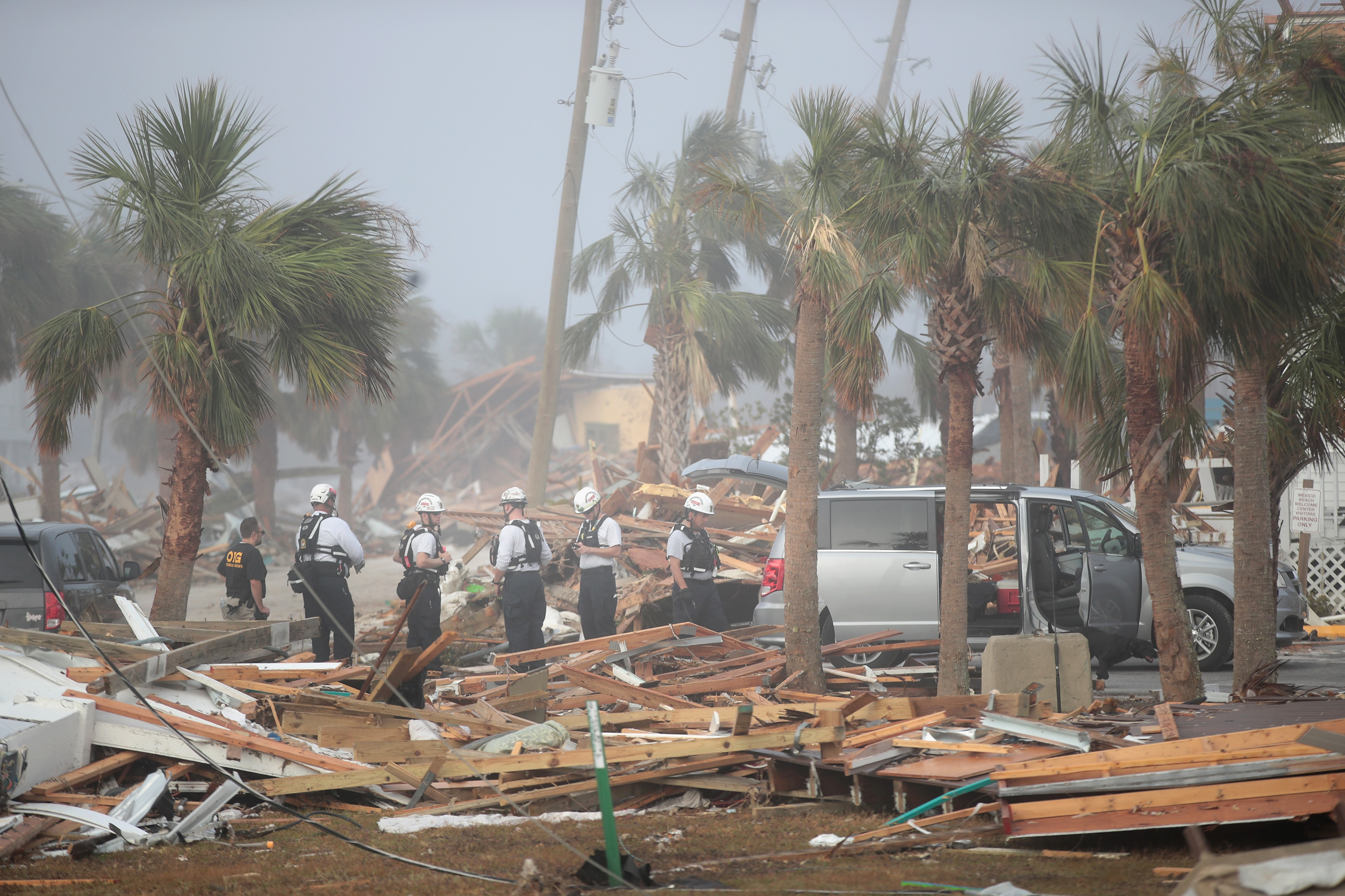 MEXICO BEACH, FL - OCTOBER 16: Members of the Maryland Task Force urban search and rescue team continue to search for victims of Hurricane Michael on October 16, 2018 in Mexico Beach, Florida. Hurricane Michael slammed into the Florida Panhandle on October 10, as a category 4 storm, claiming at least 19 lives and causing massive damage. (Scott Olson/Getty Images)