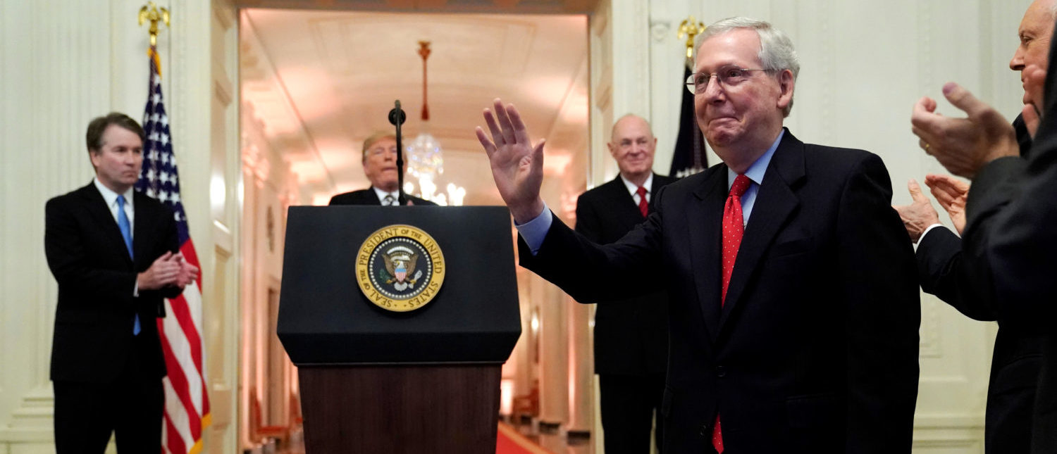 U.S. Senate Republican leader Mitch McConnell is applauded during the ceremonial public swearing-in for Supreme Court Associate Justice Brett Kavanaugh at the East Room of the White House in Washington, U.S. October 8, 2018. REUTERS/Jonathan Ernst