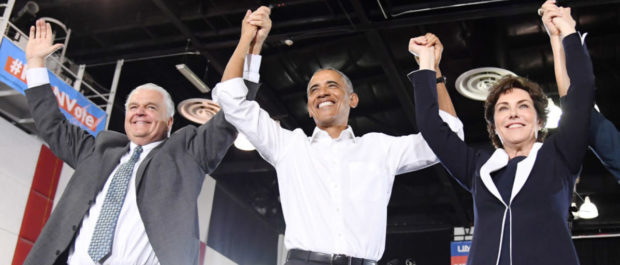 LAS VEGAS, NEVADA - OCTOBER 22: (L-R) Clark County Commission Chairman and Democratic gubernatorial candidate Steve Sisolak, former U.S. President Barack Obama U.S. Rep. and U.S. Senate candidate Jacky Rosen (D-NV) hold hands and raise their arms after speaking at a get-out-the-vote rally at the Cox Pavilion as Obama campaigns for Nevada Democratic candidates on October 22, 2018 in Las Vegas, Nevada. (Ethan Miller/Getty Images)