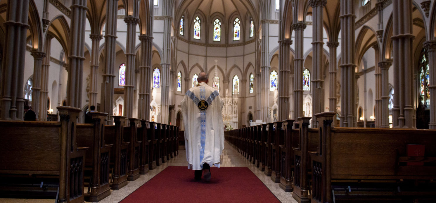 Father Kris Stubna walks to the sanctuary following a mass to celebrate the Assumption of the Blessed Virgin Mary at St Paul Cathedral, the mother church of the Pittsburgh Diocese on Aug. 15, 2018 in Pittsburgh, Pennsylvania. The Pittsburgh Diocese was rocked by revelations of abuse by priests the day before on Aug. 14, 2018. (Photo by Jeff Swensen/Getty Images)