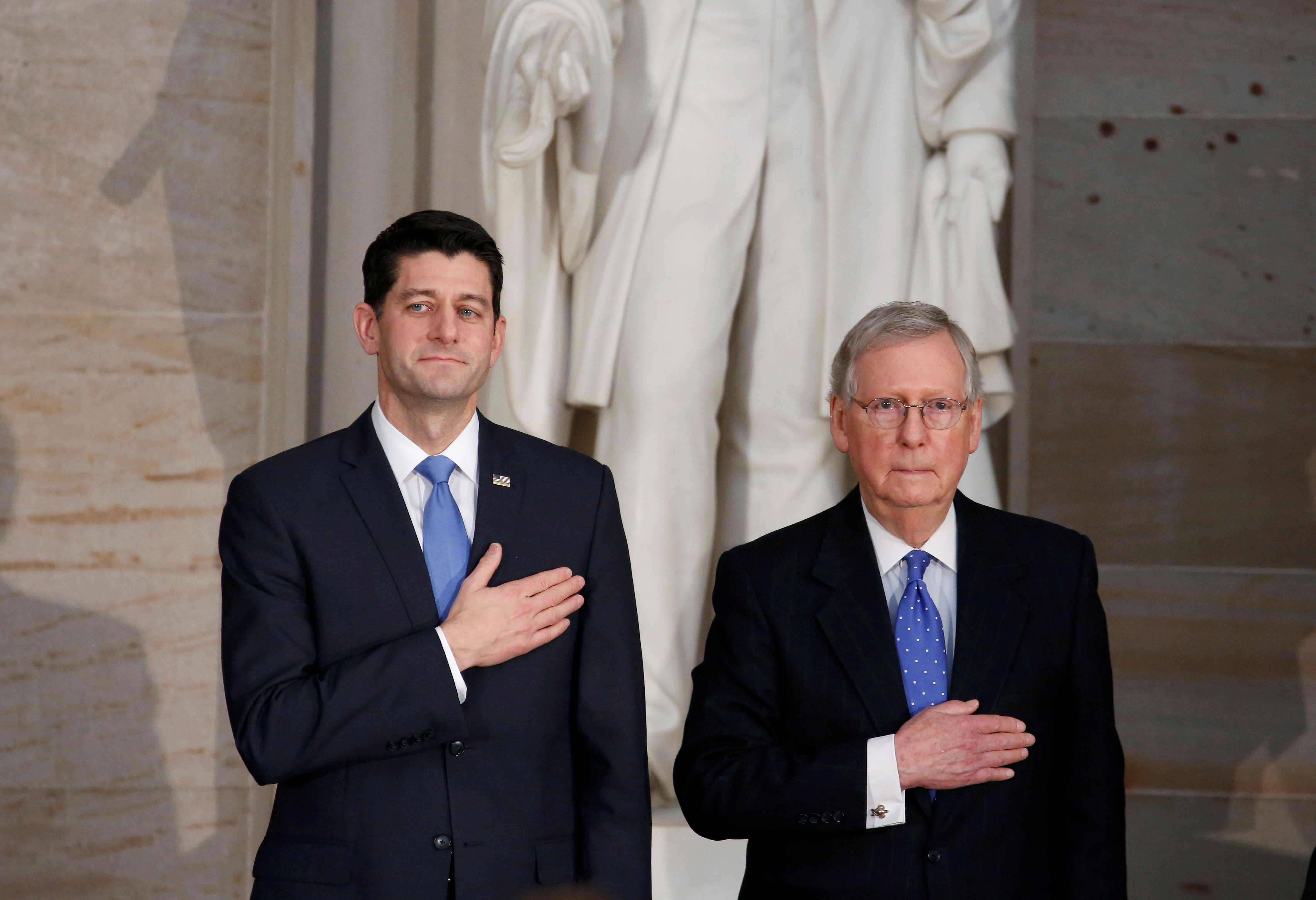 Speaker of the House Paul Ryan (R-WI) and Senate Majority Leader Mitch McConnell (R-KY) stand during a Congressional Gold Medal ceremony in Washington