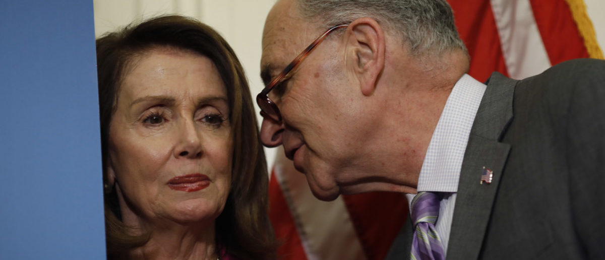 Senate Minority Leader Chuck Schumer and House Minority Leader Nancy Pelosi (Photo by Aaron P. Bernstein/Getty Images)