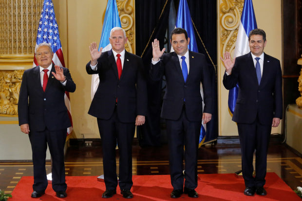(L-R) El Salvador's President Salvador Sanchez Ceren, U.S. Vice President Mike Pence, Guatemala's President Jimmy Morales and Honduras' President Juan Orlando Hernandez wave during a photo opportunity before a meeting at the National Palace of Culture in Guatemala City, Guatemala June 28, 2018. REUTERS/Luis Echeverria