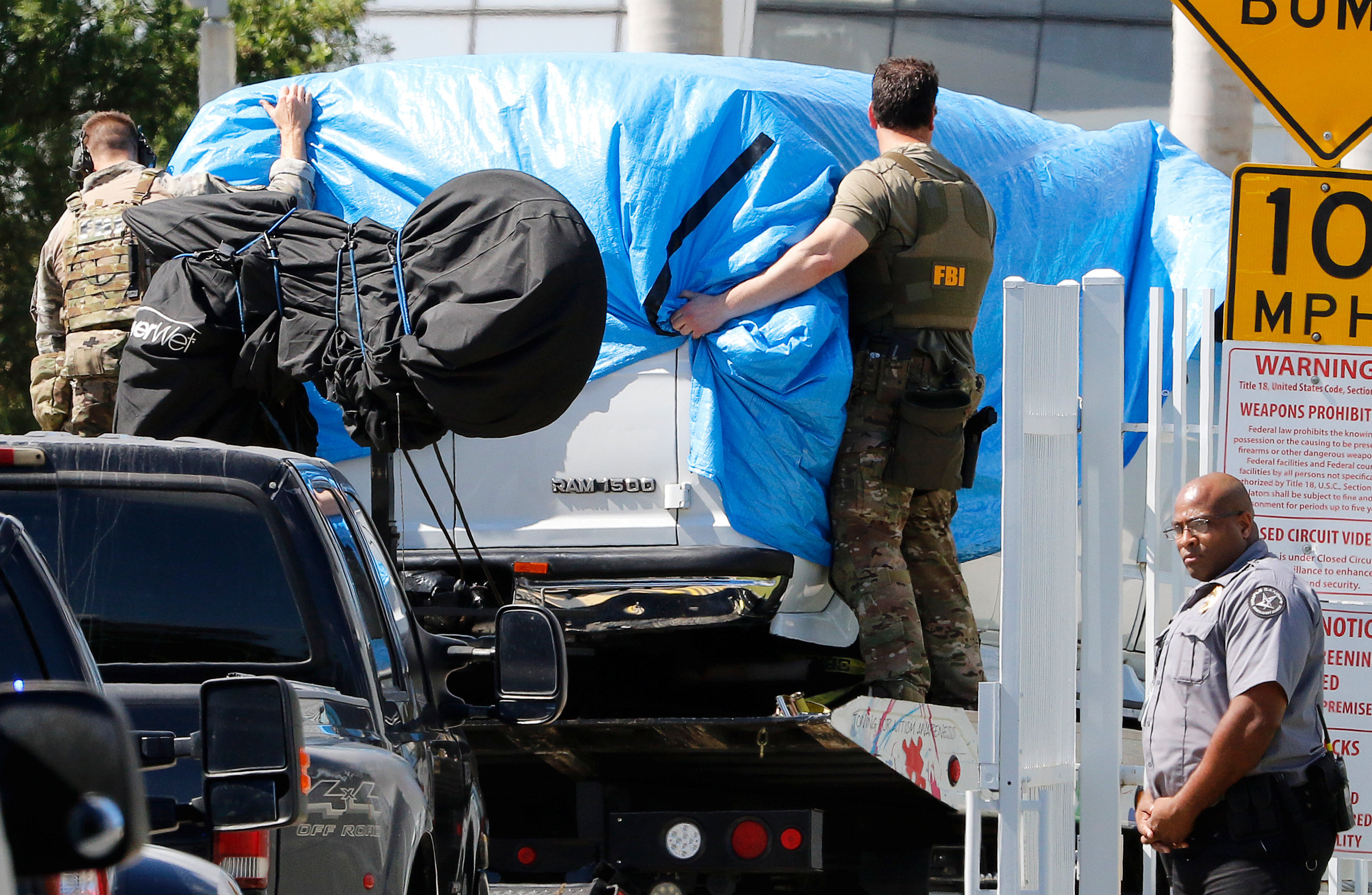 A white van seized during an investigation into a series of parcel bombs is towed into FBI headquarters in Miramar, Florida, October 26, 2018. REUTERS/Joe Skipper