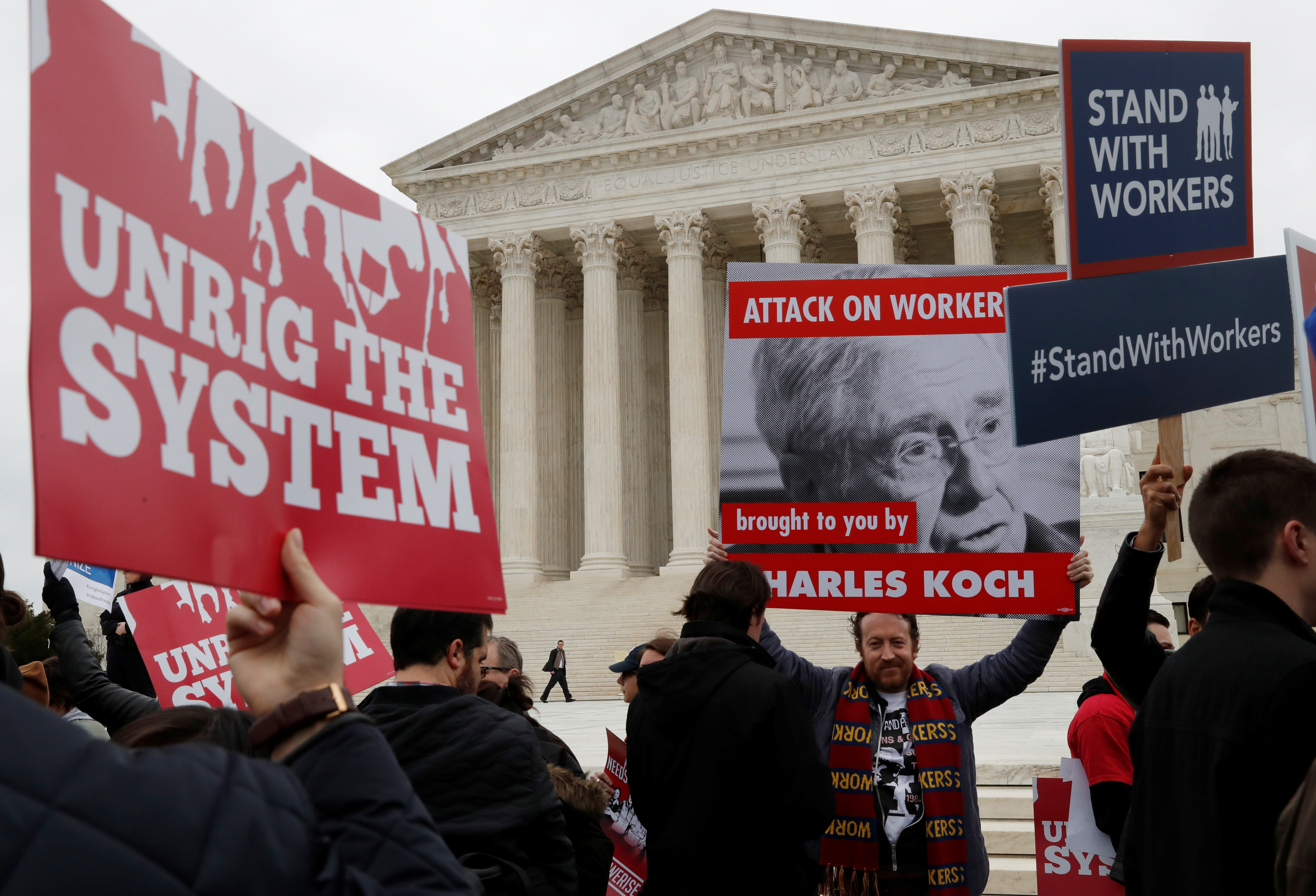 Union members gather outside of the United States Supreme Court in Washington, U.S., February 26, 2018. REUTERS/Leah Millis