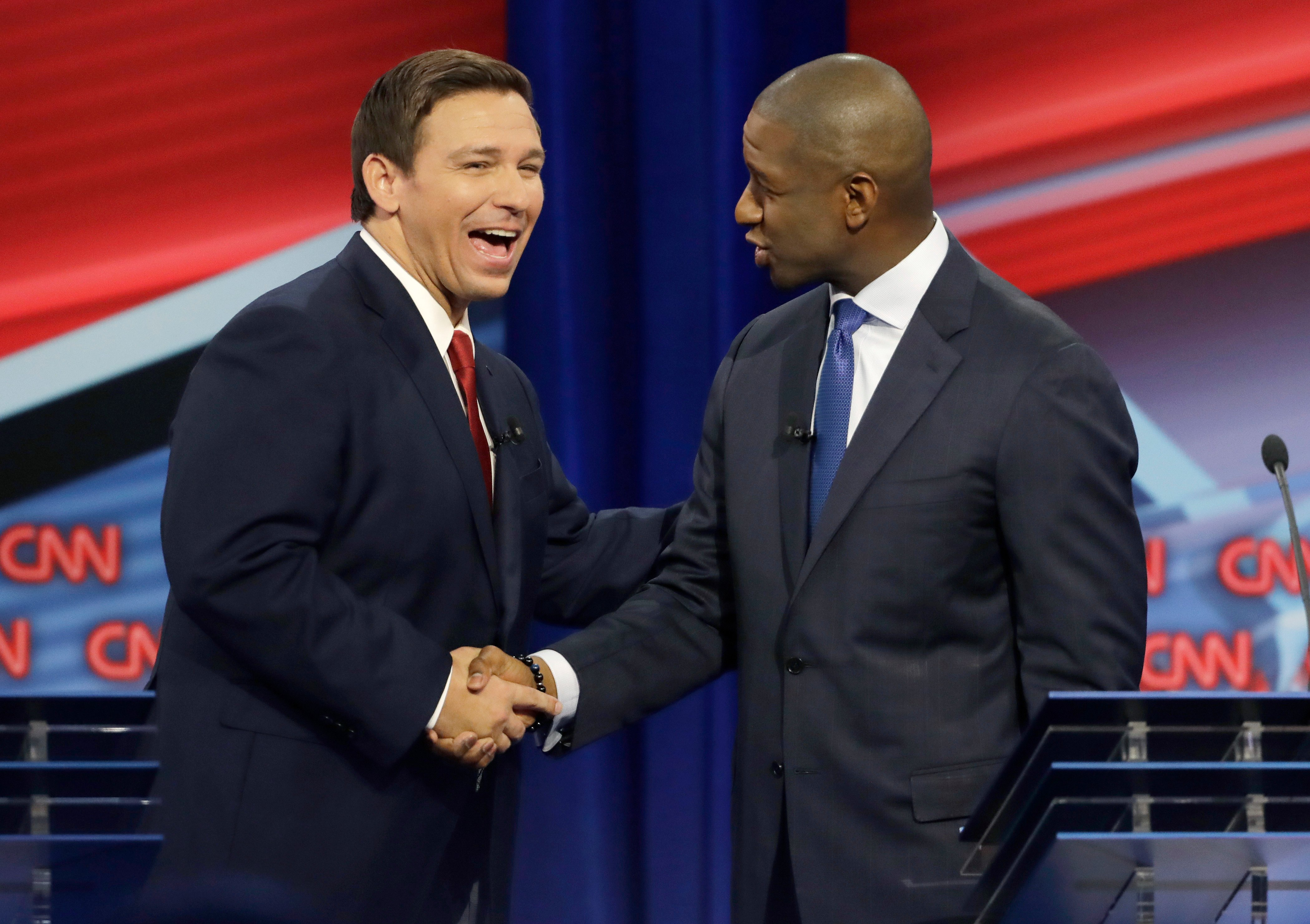 TAMPA, FLORIDA - OCTOBER 21: Florida Republican gubernatorial candidate Ron DeSantis, left, shakes hands with Democratic gubernatorial candidate Andrew Gillum after a CNN debate, Sunday, Oct. 21, 2018, in Tampa, Fla. (Photo by Chris O'Meara-Pool/Getty Images)