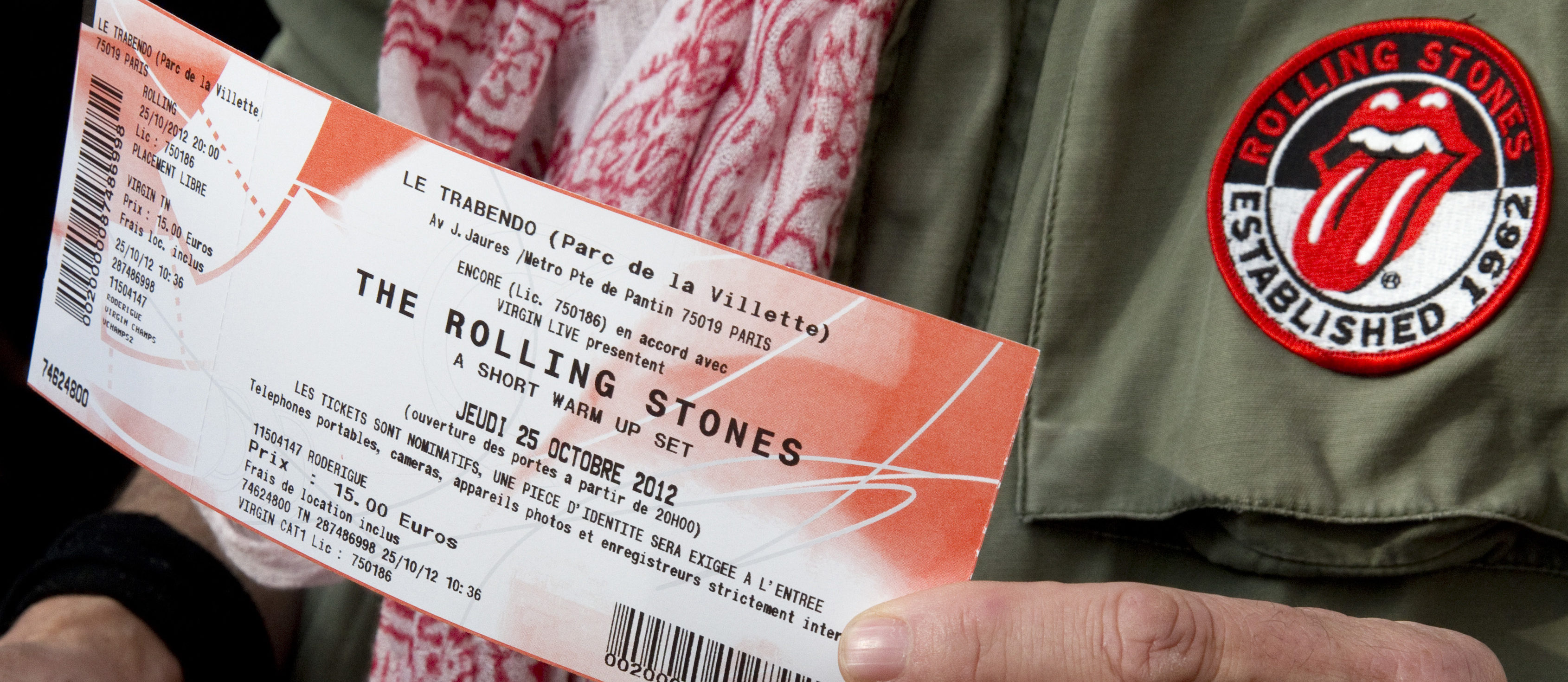 A Rolling Stones fan displays two tickets he purchased for a short warm-up gig in Paris October 25, 2012 as the group prepares for a series of 50th anniversary concerts later this year. The Rolling Stones will perform in Paris later on Thursday for a few hundred fans who bought tickets for 15 euros ($19.45) each at a music store in the centre of the city. REUTERS/Philippe Wojazer (FRANCE - Tags: ENTERTAINMENT BUSINESS) - PM1E8AP0Y5101