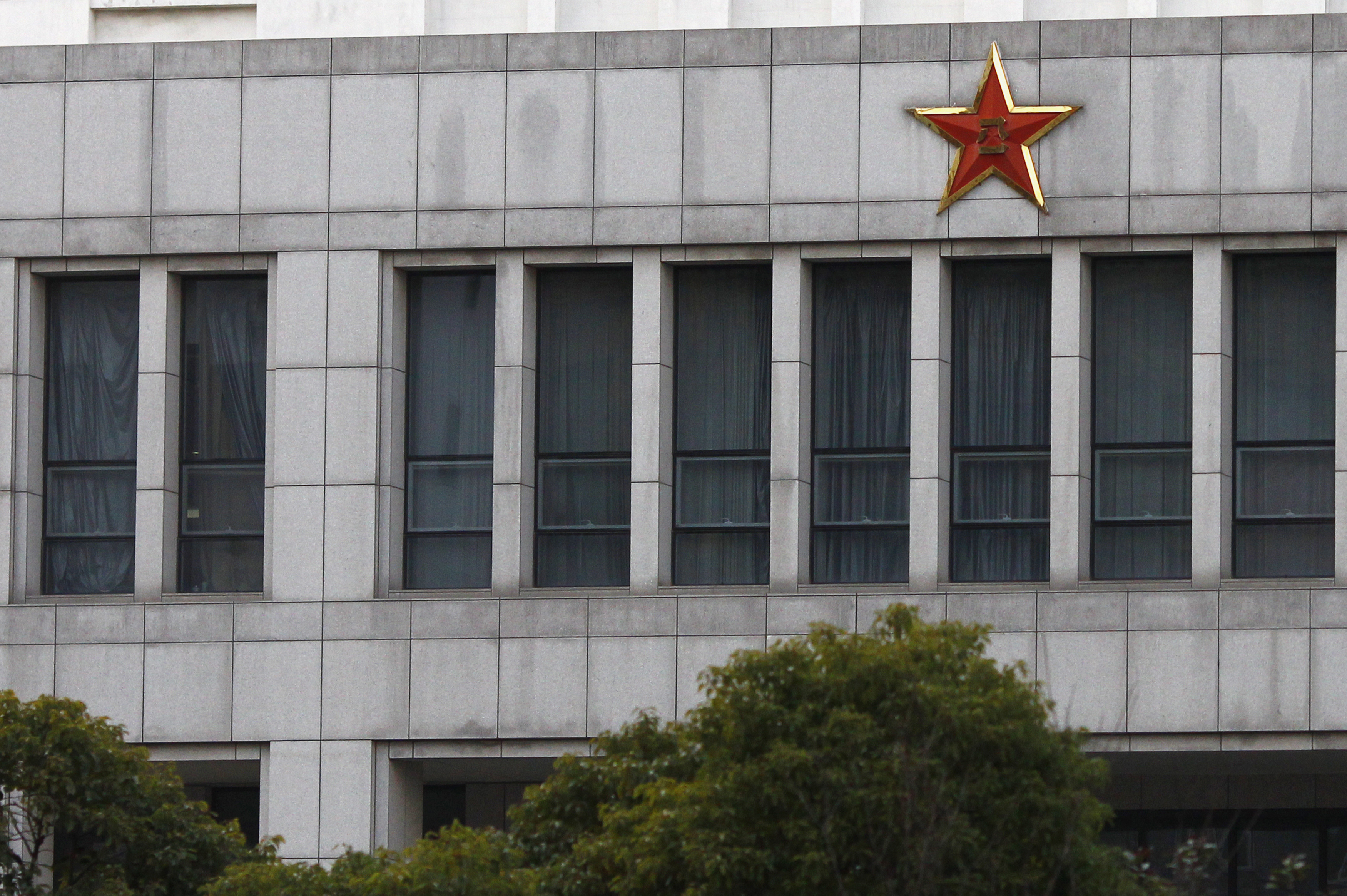 Part of the building of 'Unit 61398', a secretive Chinese military unit, is seen in the outskirts of Shanghai February 19, 2013. The unit is believed to be behind a series of hacking attacks, a U.S. computer security company said, prompting a strong denial by China and accusations that it was in fact the victim of U.S. hacking. REUTERS/Carlos Barria