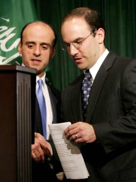Adel Al-Jubeir (L), Foreign Affairs Advisor to the Saudi Crown Prince, shakes hands with Juan Zarate, Deputy Assistant Secretary for Terrorist Financing and Financial Crimes at the U.S. Treasury Department, during a joint press conference at the Royal Embassy of Saudi Arabia in Washington, June 2, 2004. The joint press conference outlined the latest steps both nations are taking to counter potential attacks by identifying and shutting down the financial sources that support terrorism. REUTERS/Jason Reed