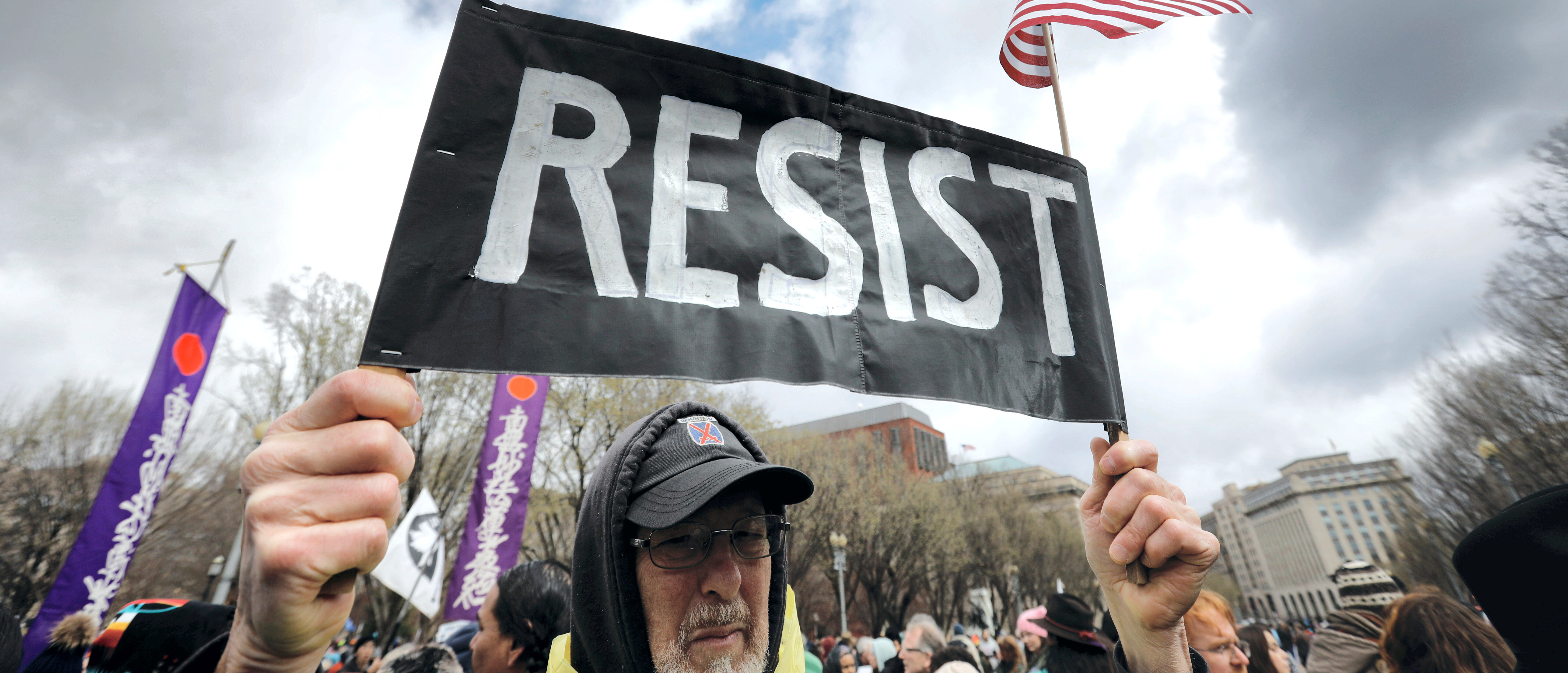 A protestor holds a Resist sign as indigenous activists and supporters hold a protest march and rally in opposition to the Dakota Access and Keystone XL pipelines in Washington, U.S., March 10, 2017. REUTERS/Kevin Lamarque - RC19F0C22C50