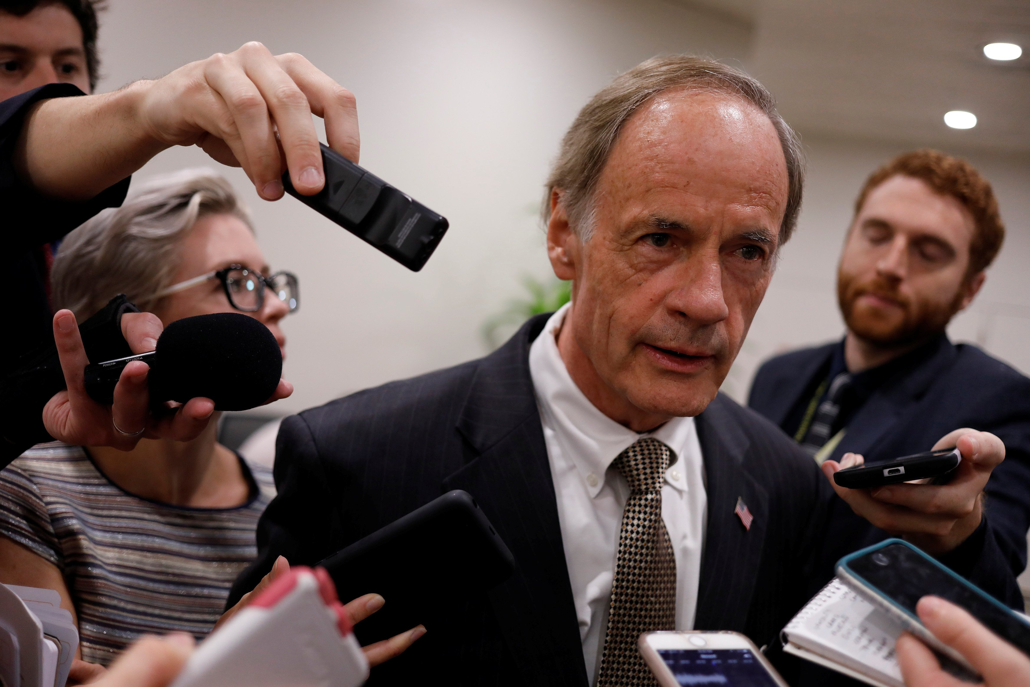Senator Tom Carper speaks to reporters ahead of the weekly party luncheons on Capitol Hill in Washington