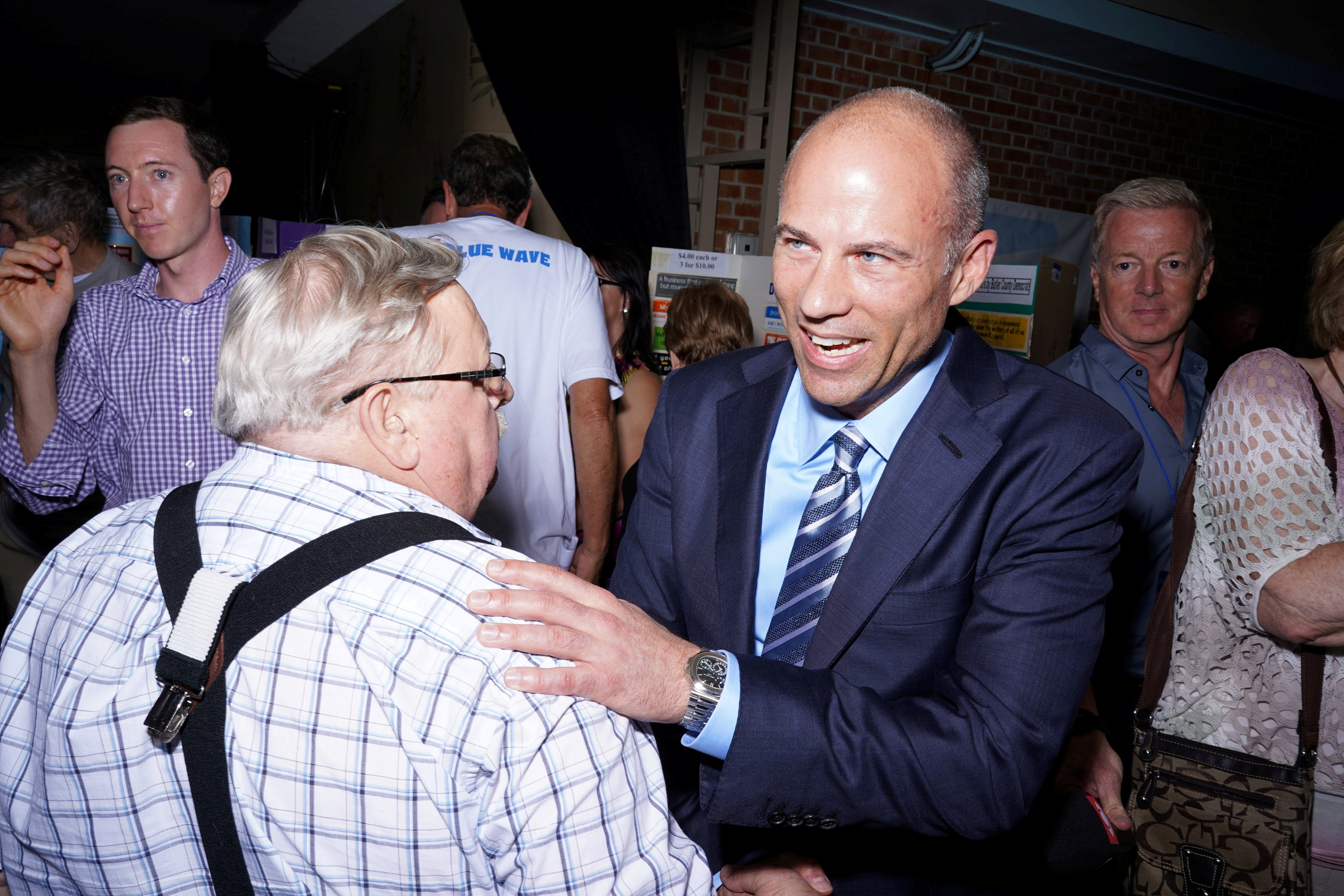 Michael Avenatti talks with supporters after speaking at the Iowa Democratic Wing Ding in Clear Lake, Iowa, U.S., August 10, 2018. Picture taken August 10, 2018. REUTERS/KC McGinnis - RC16EB375840