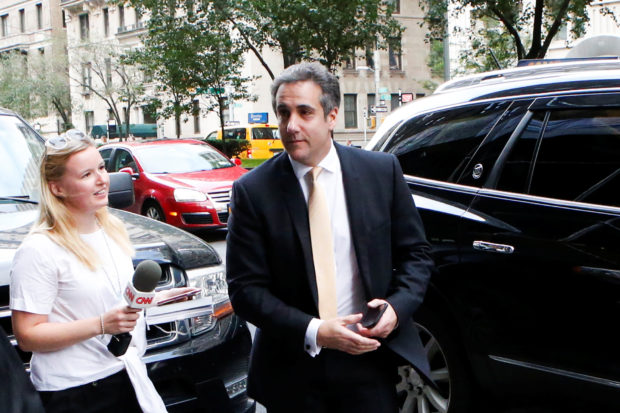 U.S. President Donald Trump's former lawyer, Michael Cohen, arrives to his apartment building after attending the federal court in New York City, U.S. August 21, 2018. REUTERS/Eduardo Munoz