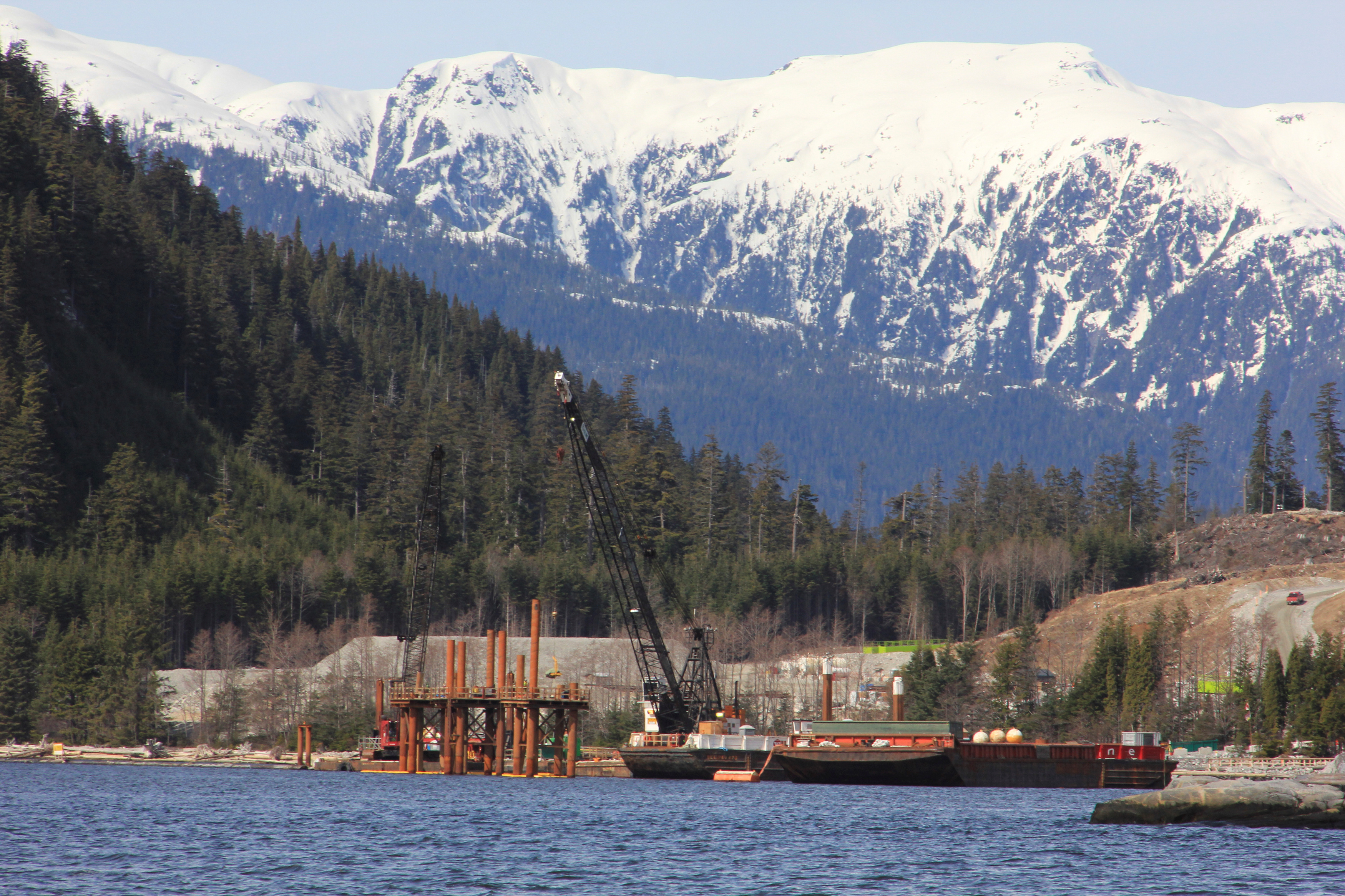 FILE PHOTO: Cranes in the water at the Kitimat LNG site near Kitimat, in northwestern British Columbia