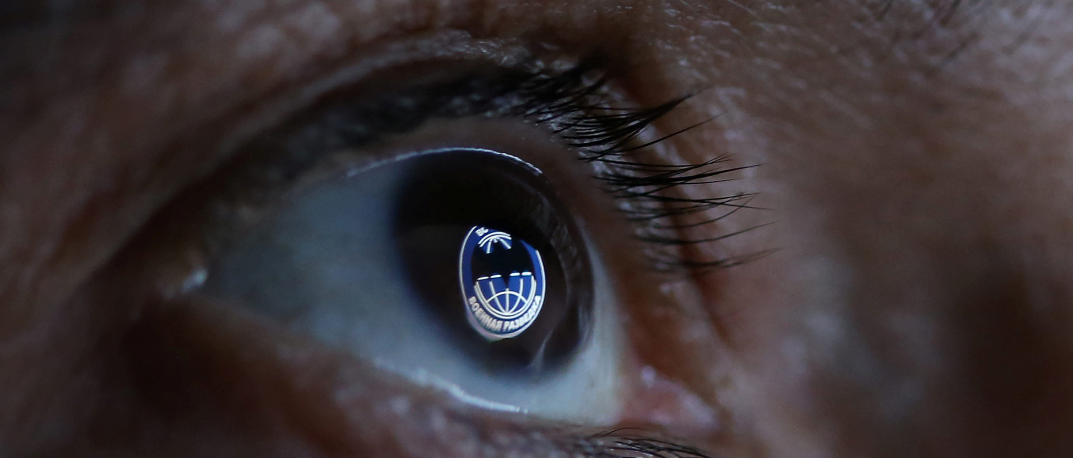 GRU, Russia's Main Intelligence Directorate logo is reflected in an eye in this picture illustration taken October 4, 2018. REUTERS/Dado Ruvic/Illutration