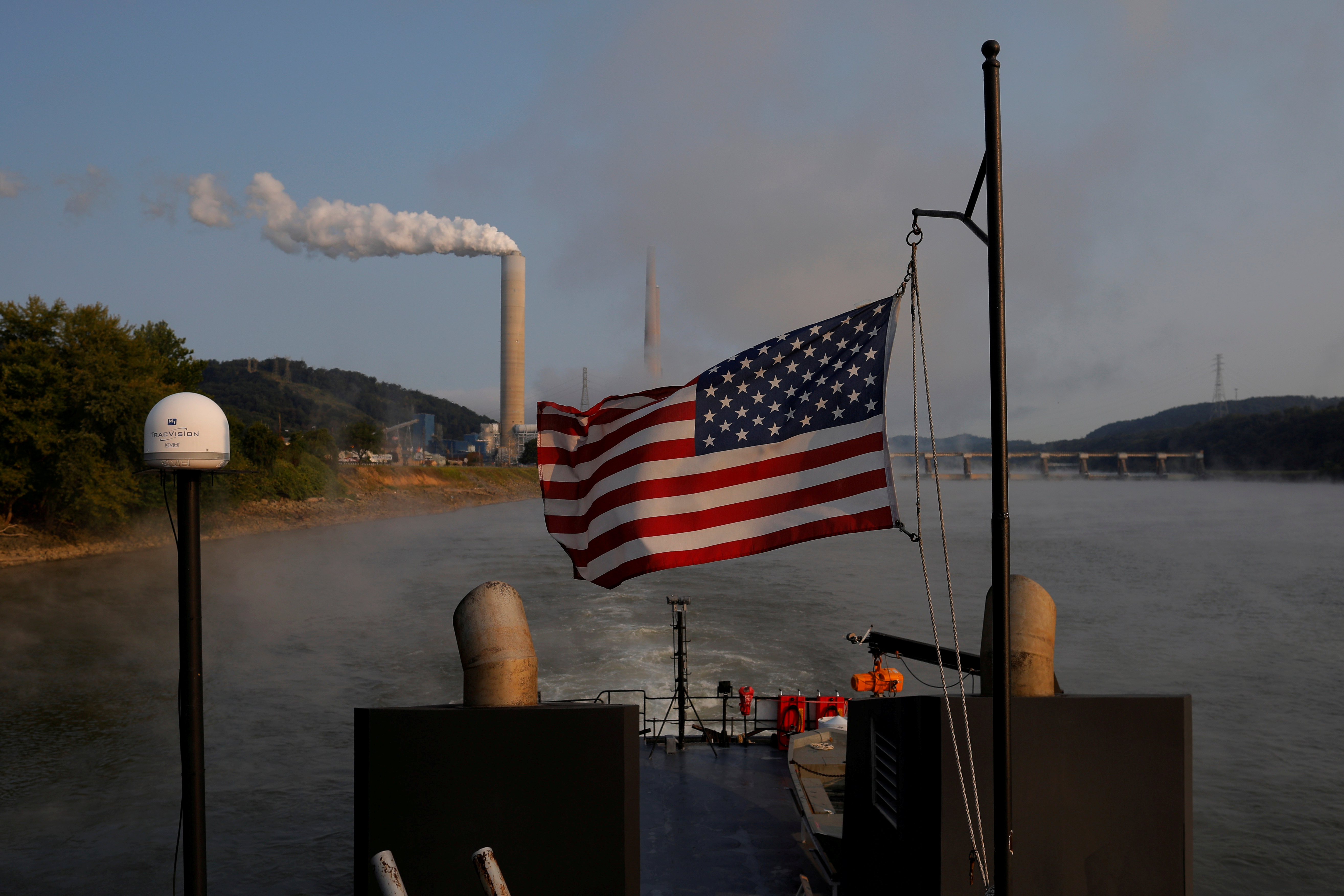 FILE PHOTO: The U.S. flag flies on Campbell Transportation's towboat M.K. McNally as it passes the W. H. Sammis Power Plant along the Ohio River in Stratton