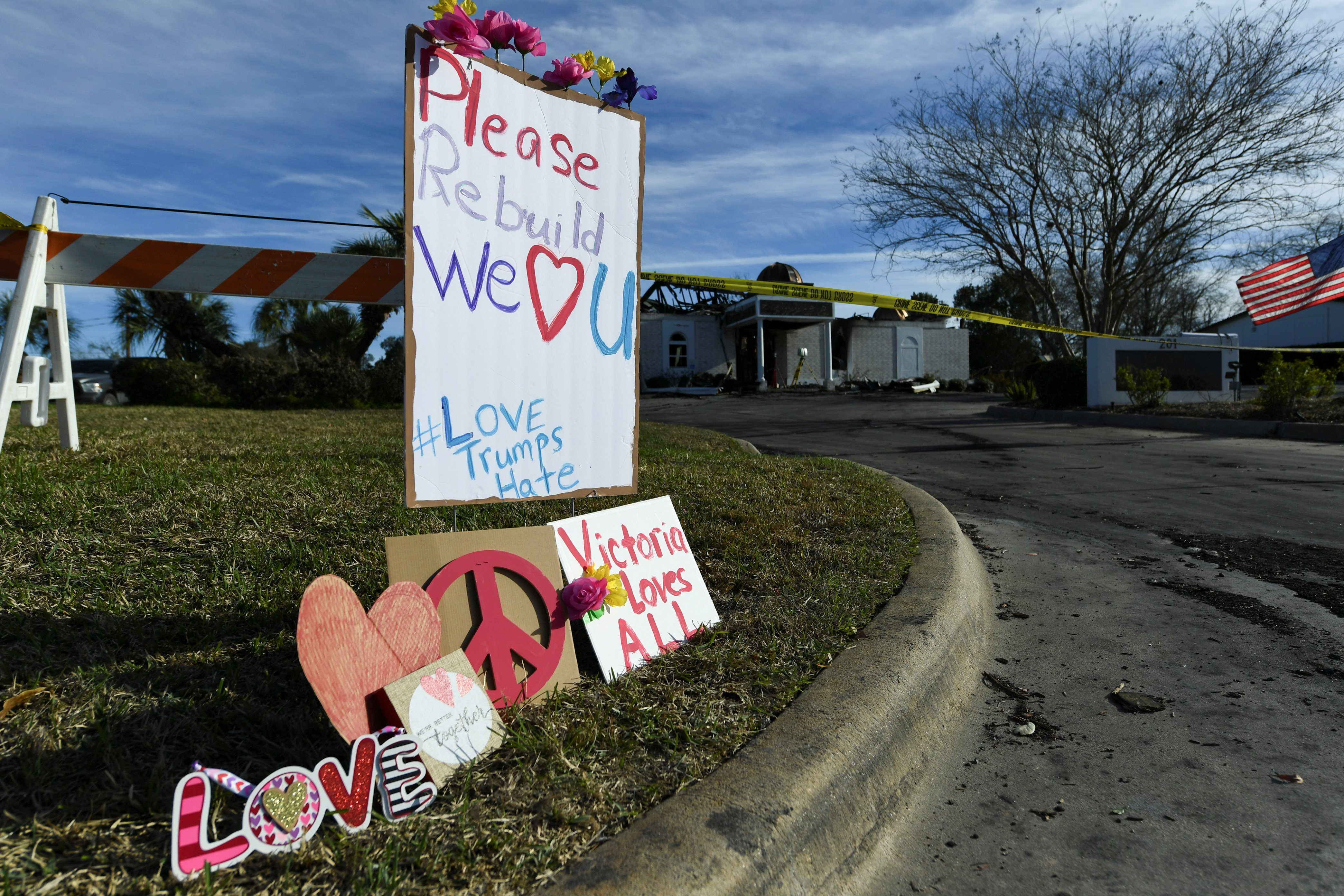 Signs rest outside the Victoria Islamic Center a day after a fire destroyed the mosque in Victoria, Texas January 29, 2017. REUTERS/Mohammad Khursheed