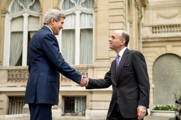U.S. Secretary of State John Kerry greets Saudi Foreign Minister Adel al-Jubeir (R) outside the Chief of Mission Residence in Paris, France, May 8, 2015, before a meeting with the foreign ministers of the Gulf Cooperation Council to discuss Middle East concerns about an emerging nuclear deal with Iran. (REUTERS/Andrew Harnik/Pool)