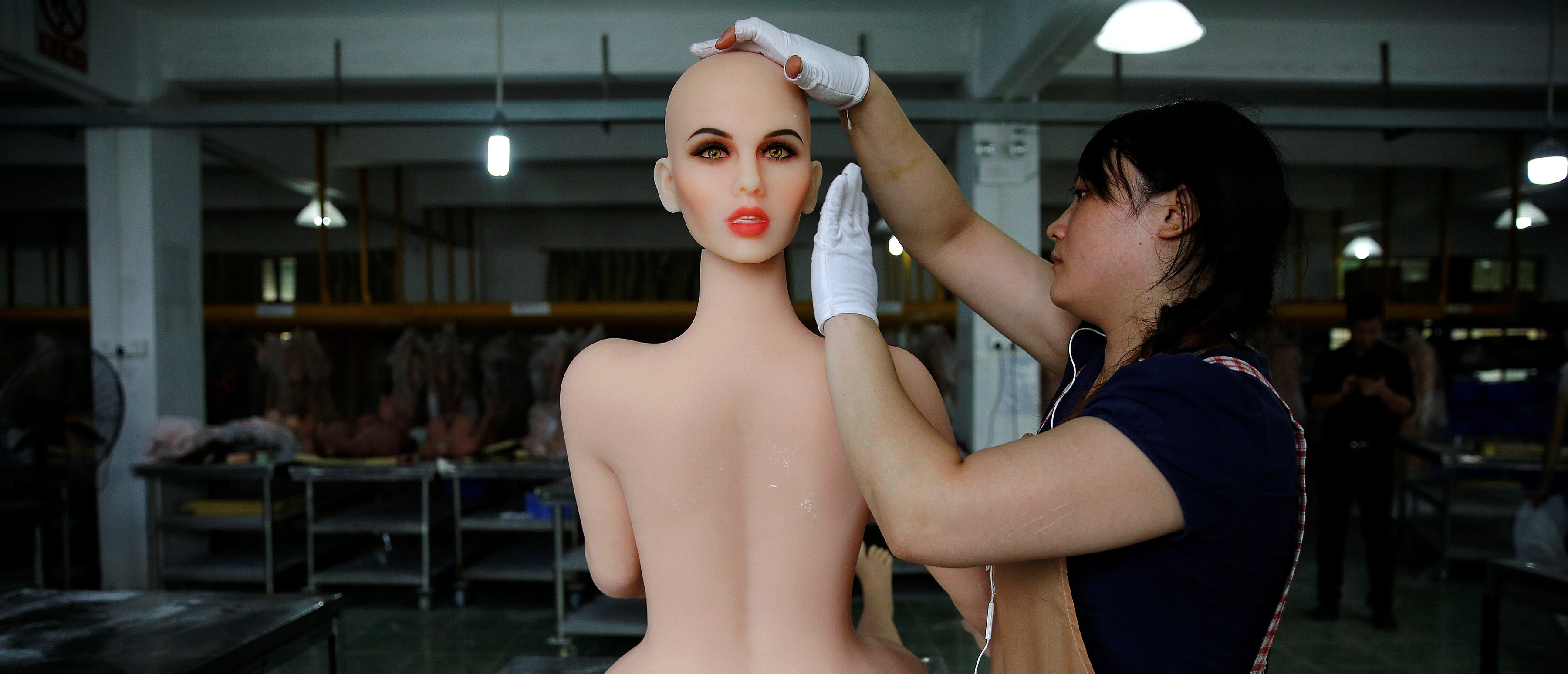 """A worker assembles a sex doll at the WMDOLL factory in Zhongshan, Guangdong Province, China, July 11, 2018. The factory has over 200 full-time workers, all dolls are handmade and each requires the cooperation of at least five workers. REUTERS/Aly Song SEARCH """"SONG DOLLS"""" FOR THIS STORY. SEARCH """"WIDER IMAGE"""" FOR ALL STORIES. TPX IMAGES OF THE DAY. - RC181D2A1690"""