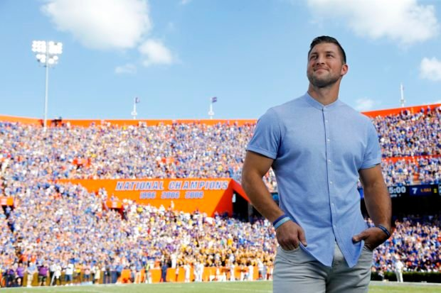 Oct 6, 2018; Gainesville, FL, USA; Florida Gators former quarterback Tim Tebow is inducted into the Ring of Honor at the end of the first quarter against the LSU Tigers at Ben Hill Griffin Stadium. Mandatory Credit: Kim Klement-USA TODAY Sports - 11388646