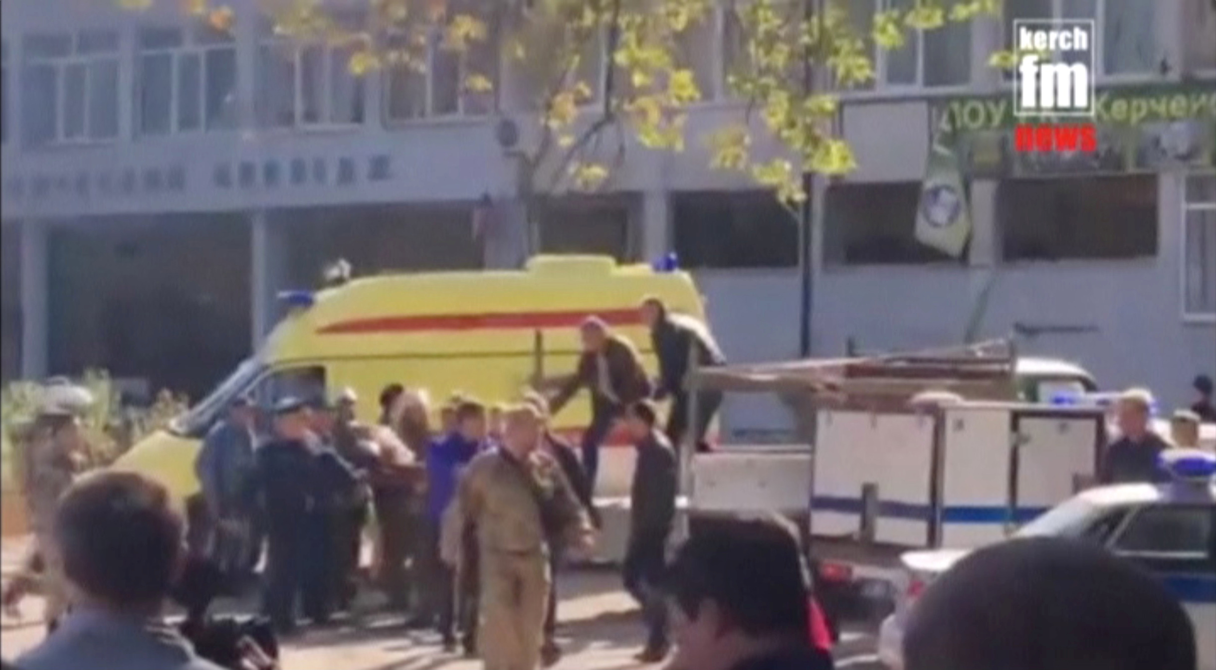 Emergency services carry an injured victim of a blast at at a college in the port city of Kerch, Crimea in this still image taken from a video on October 17, 2018. Kerch.FM/Handout via REUTERS TV ATTENTION EDITORS - THIS PICTURE WAS PROVIDED BY A THIRD PARTY. NO RESALES. NO ARCHIVES - RC1D0DC98200