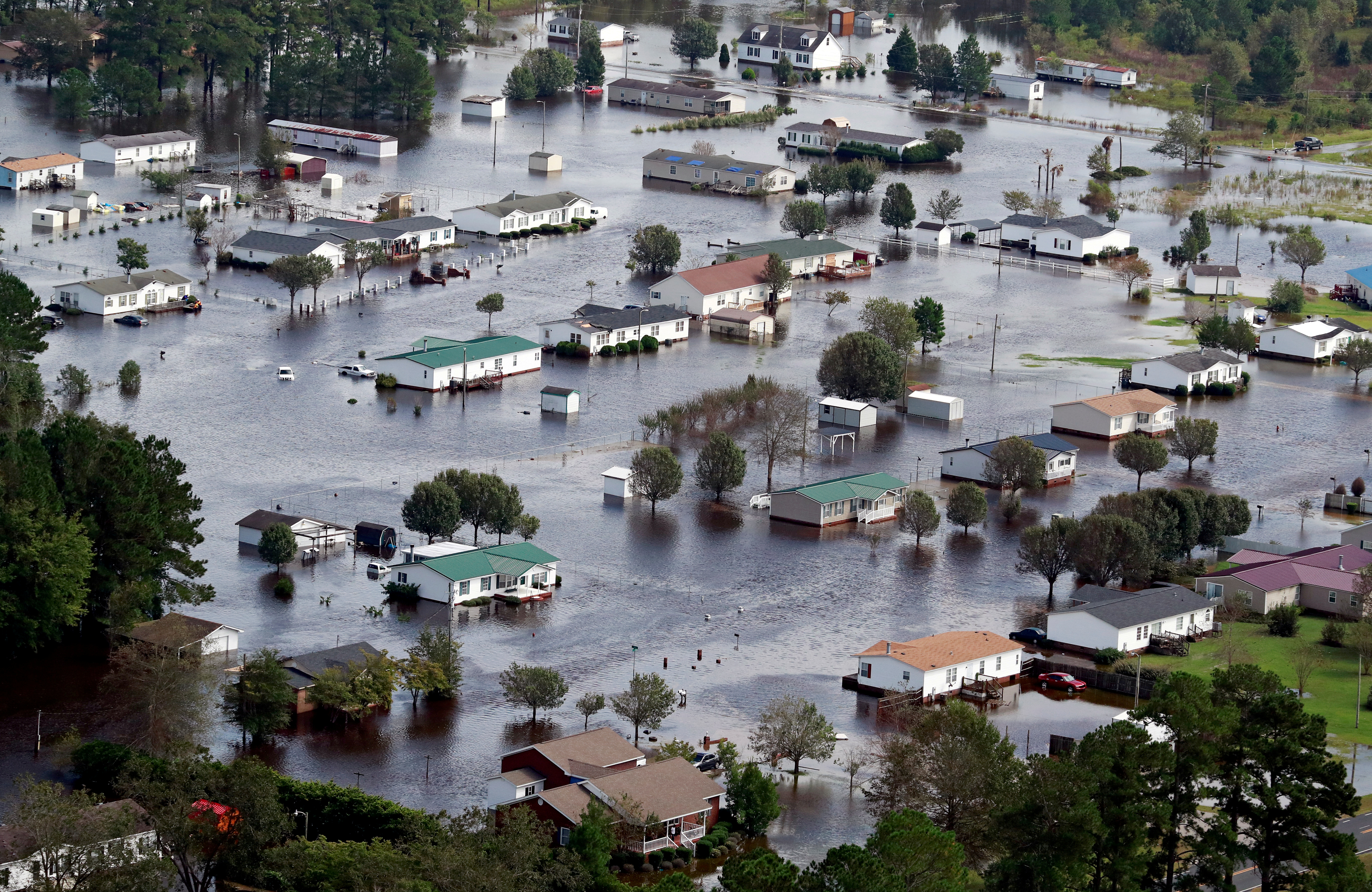 FILE PHOTO: FILE PHOTOS: Houses sit in floodwater caused by Hurricane Florence in this aerial picture in Lumberton
