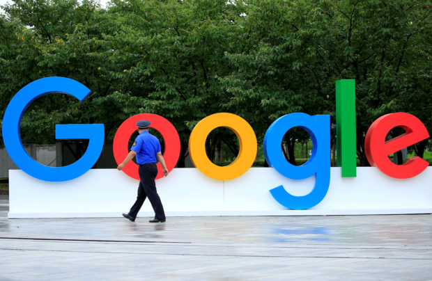 FILE PHOTO: A Google sign is seen during the WAIC (World Artificial Intelligence Conference) in Shanghai, China, September 17, 2018. REUTERS/Aly Song/File Photo GLOBAL BUSINESS WEEK AHEAD - RC18FABCED70