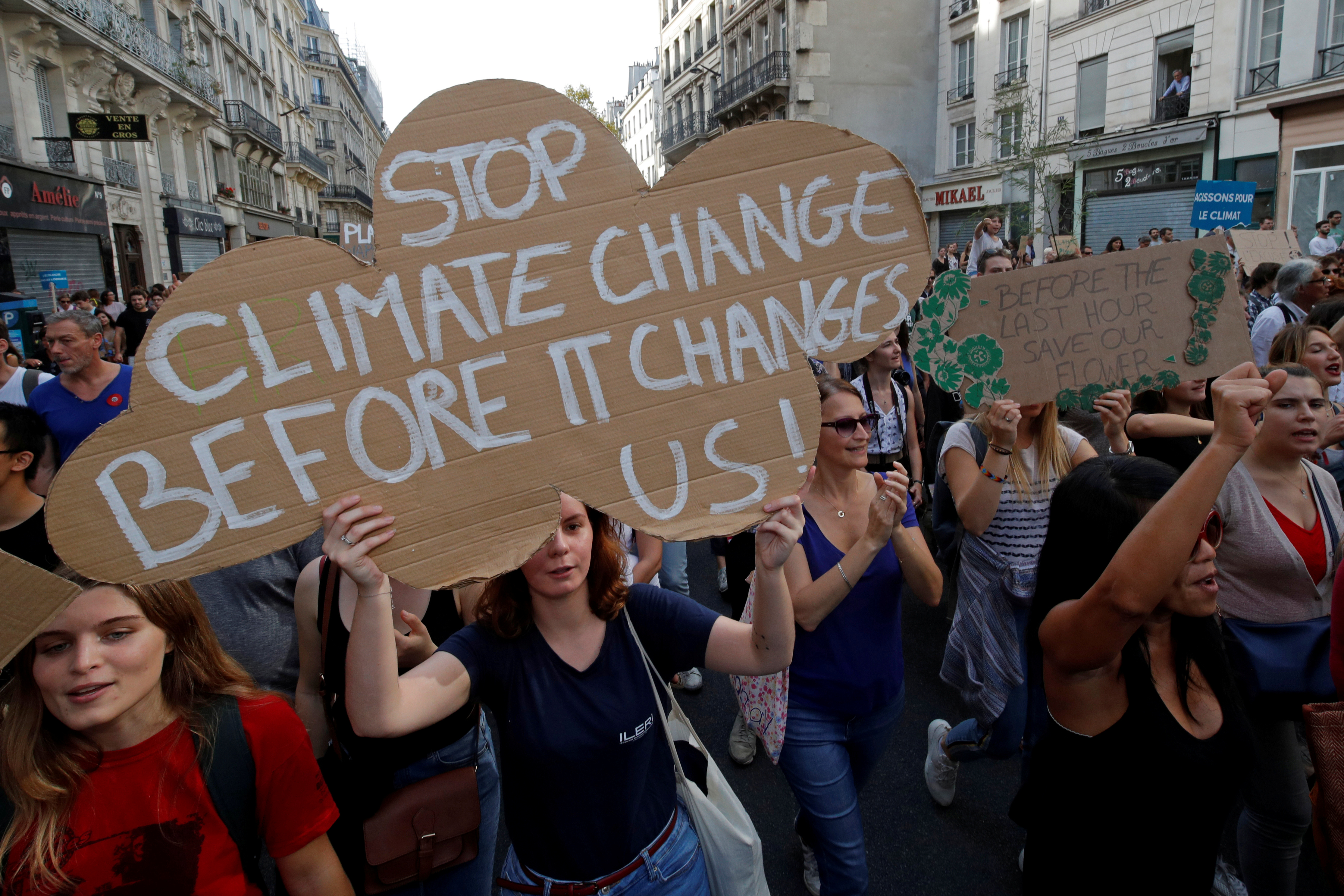 FILE PHOTO: Protesters march to urge politicians to act against climate change in Paris