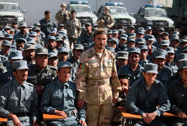 In this photo taken on February 19, 2017, Afghan General Abdul Raziq (C), police chief of Kandahar, poses for a picture during a graduation ceremony at a police training centre in Kandahar province. - An Afghan security chief and a journalist were killed and three Americans wounded on October 18 when a gunman opened fire on a high-level security meeting attended by top US commander General Scott Miller, officials said. JAWED TANVEER/AFP/Getty Images