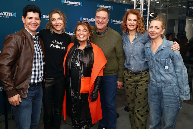 Actors Michael Fishman, Sarah Chalke, Roseanne Barr, John Goodman, SiriusXM host Sandra Bernhard and Lecy Goranson pose for photos during SiriusXM's Town Hall with the cast of Roseanne on March 27, 2018 in New York City. (Photo by Astrid Stawiarz/Getty Images for SiriusXM)