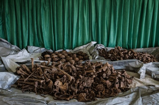 A picture taken on April 30, 2018, shows collected victims' bones and skulls from a newly discovered pit which was used as mass grave during 1994 Rwandan genocide and hidden under a house at the local administration office in Kabuga, the outskirts of Kigali, Rwanda. (YASUYOSHI CHIBA/AFP/Getty Images)