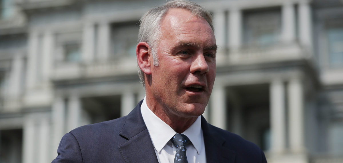 """WASHINGTON, DC - AUGUST 16: Interior Secretary Ryan Zinke talks to journalists outside the White House West Wing before attending a cabinet meeting with President Donald Trump August 16, 2018 in Washington, DC. Zinke said the historic wild fires in the west are caused by mismanaged public lands and """"environmental terrorists groups"""" that work to prevent logging and clearing dead trees and debris that fuel fires. (Photo by Chip Somodevilla/Getty Images)"""