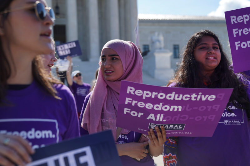 Pro-life and pro-choice protesters rally outside the U.S. Supreme Court waiting for the National Institute of Family and Life Advocates v. Becerra case which remains pending, in Washington, U.S., June 25, 2018. REUTERS/Toya Sarno Jordan