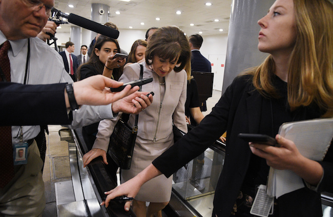 Senator Susan Collins (R-ME) is surrounded by reporters as she arrives for a procedural vote in the Senate on the confirmation of U.S. Supreme Court nominee Brett Kavanaugh on Capitol Hill in Washington, October 5, 2018. REUTERS/Mary Calvert