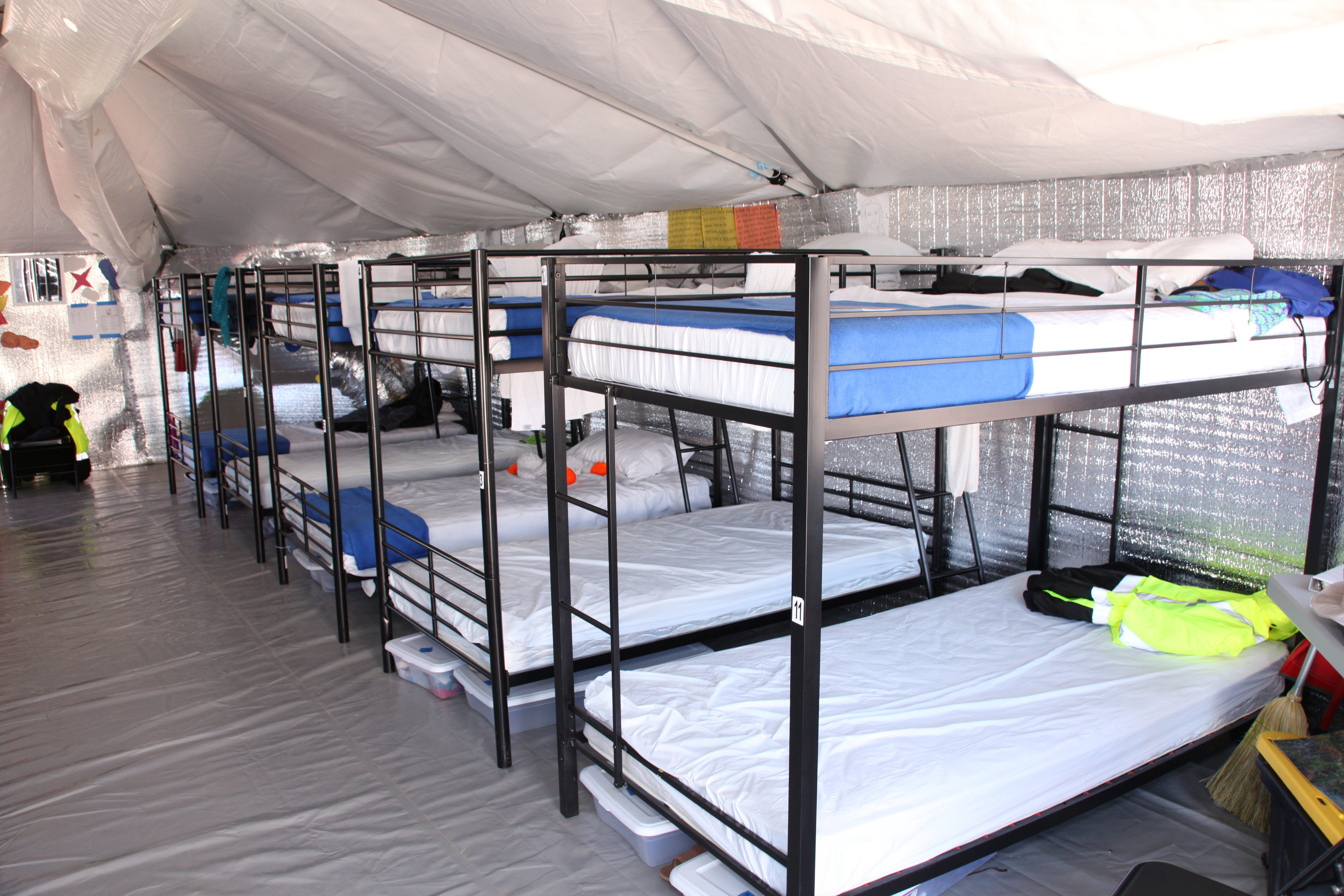 Bunk beds are seen at a tent city set up to hold immigrant children separated from their parents or who crossed the U.S. border on their own in Tornillo, Texas, U.S., in this U.S. Department of Health and Human Services (HHS) image released on October 12, 2018. Courtesy HHS/Handout via REUTERS
