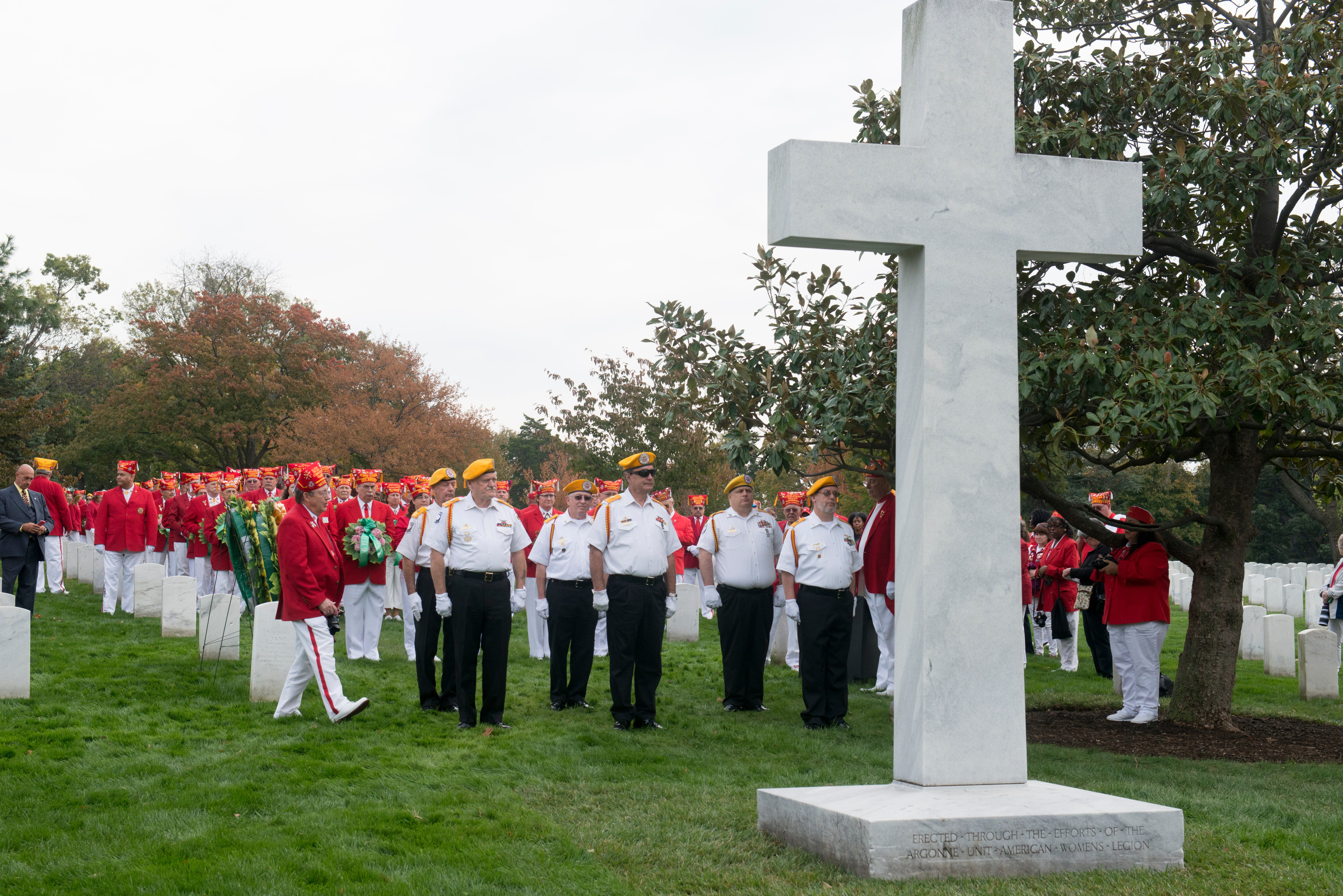Members of the United States Military Order of the Cootie, 'The Honor Degree of the Veterans of Foreign Wars,' place approximately 250 wreaths at the Argonne Cross in Section 18 of Arlington National Cemetery, Oct. 30, 2016. The MOC was founded in 1920 and has made a visit to Arlington National Cemetery and the Tomb of the Unknown Soldier, known as 'Tomb Trek,' each year since 1934. (U.S. Army photo by Rachel Larue/Arlington National Cemetery)