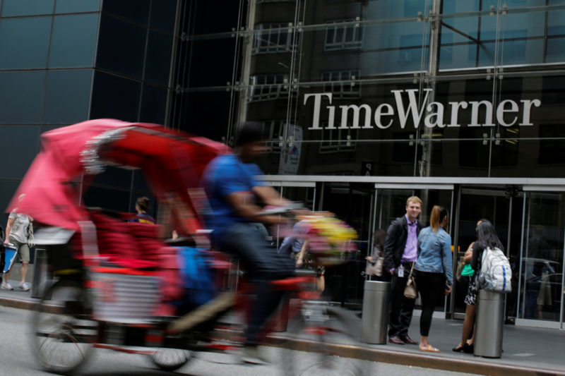 People pass by Time Warner entrance in the Manhattan borough of New York City, New York, June 15, 2018. REUTERS/Eduardo Munoz