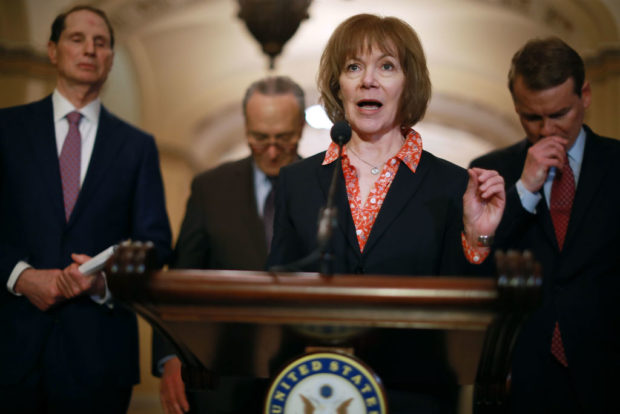 WASHINGTON, DC - APRIL 17: U.S. Sen. Tina Smith (D-MN) (C) talks with reporters as (L-R) Sen. Ron Wyden (D-OR), Senate Minority Leader Charles Schumer (D-NY) and Sen. Michael Bennet (D-CO) following the weekly Democratic policy luncheon at the U.S. Capitol April 17, 2018 in Washington, DC. (Chip Somodevilla/Getty Images)