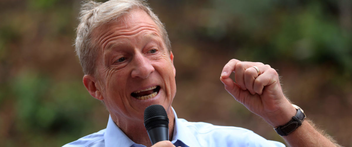 Political and climate activist Tom Steyer speaks while taking part in a protest against U.S. President Donald Trump and Republican congressman Darrell Issa (R-Vista) outside Issa's office in Vista, California, U.S., Oct. 31, 2017. REUTERS/Mike Blake