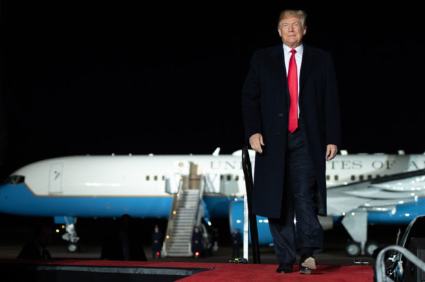 US President Donald Trump attends a campaign rally at Central Wisconsin Airport in Mosinee, Wisconsin, on October 24, 2018. (SAUL LOEB/AFP/Getty Images)