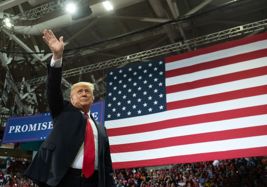 US President Donald Trump waves during a campaign rally in Estero, Florida, on October 31, 2018. (SAUL LOEB/AFP/Getty Images)