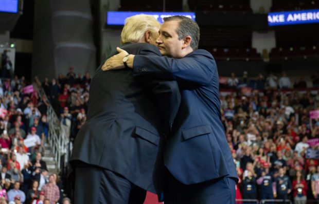 US President Donald Trump greets US Senator Ted Cruz (R), Republican of Texas, during a campaign rally at the Toyota Center in Houston, Texas, on October 22, 2018. (Photo by SAUL LOEB / AFP / Getty Images)